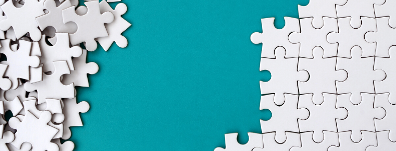white puzzle on teal background