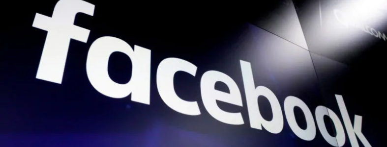 Facebook logo on blue wall