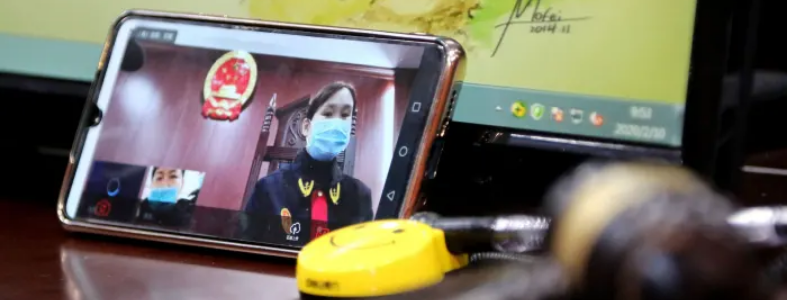 woman wearing respirator on video chat