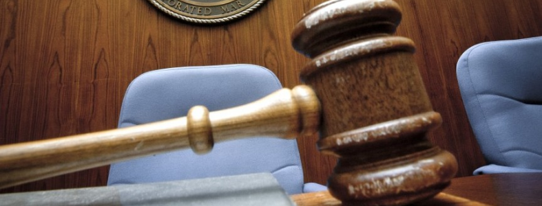 gavel on bench in court