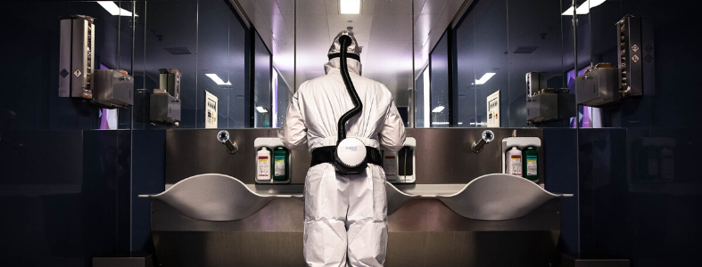 Man wearing white coveralls and SCBA in lab