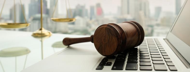 Gavel on keyboard legal tech