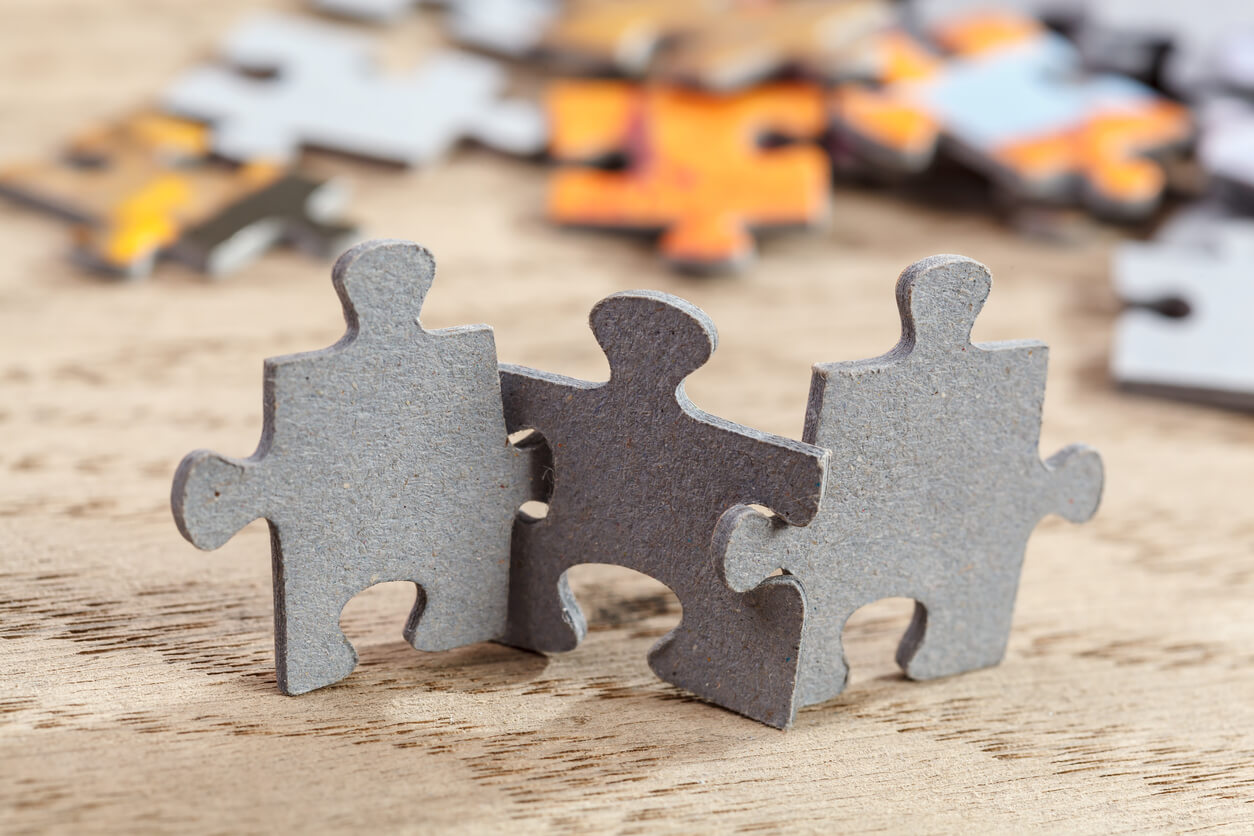 Three-Jigsaw-Puzzle-Pieces-on-Table-495266744_1258x838 (1).jpeg